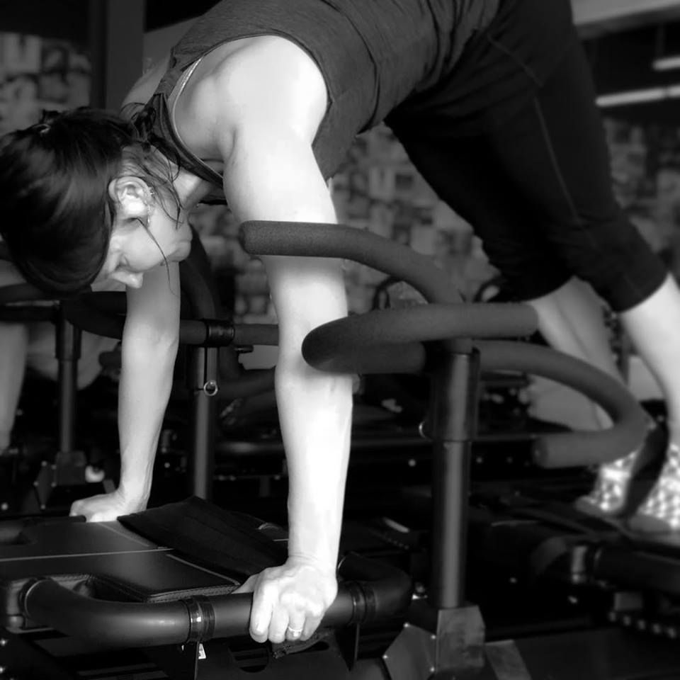 woman working out at Corus45 gym