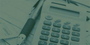 Calculator and a pen on the business table