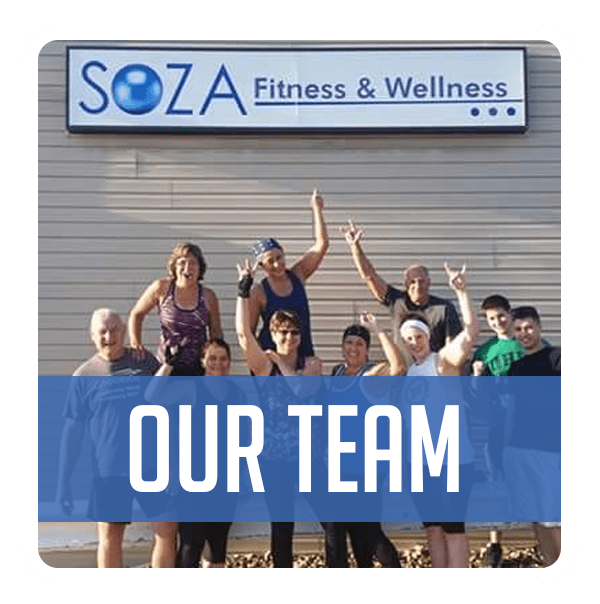 Group of men and women pose in front of SOZA Fitness and Wellness Sign. Blue bar covering lower third reads Our Team