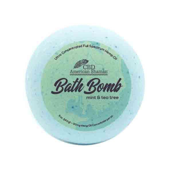Light blue bath bomb with CBD packaging.