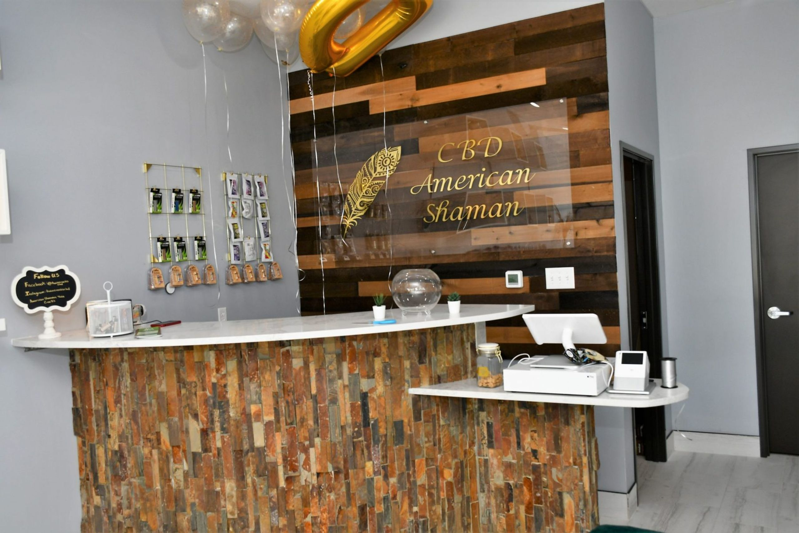 Front counter of CBD store with balloons