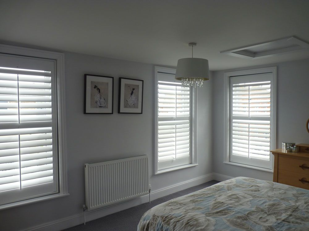 Shutter Blinds Across Three Bedroom Windows