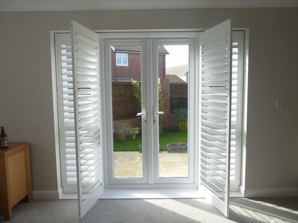 Open White Louvered Shutters Across French Doors