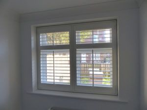 White Full Height Louvered Shutters With Central Control Rods