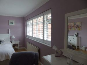 White Louvered Shutters On Wide Bedroom Window