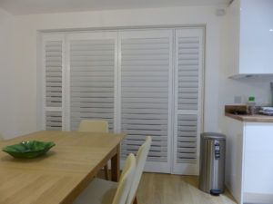 White Shutter Blinds On Kitchen Doors
