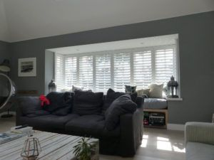 Lounge Square Bay Window With White Plantation Shutters