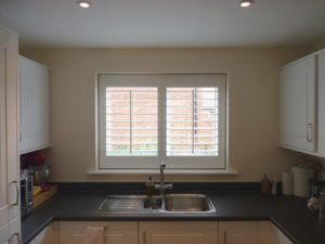 White Louvered Shutters In Kitchen Window