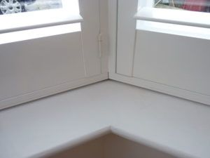 Close Up Showing Corner Join Of White Shutters In Angled Bay Window
