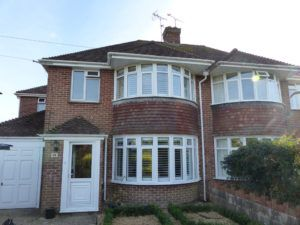 Semi-Detached House With Two Large Round Bay Window Shutters