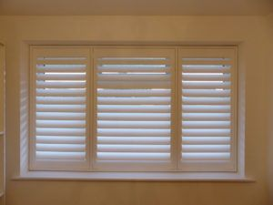 White Window Shutters With Split Louvres On Middle Section