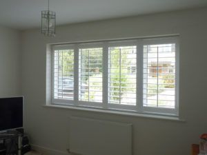 White Plantation Shutters With TPosts