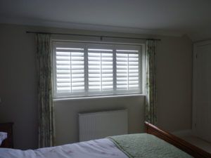 White Shutters With Tposts In Bedroom Window