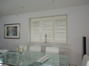 Cream Shutters With TPosts In Dining Room
